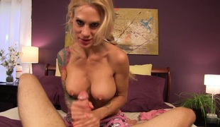 Toned busty blond slut Sarah Jessie gives a handjob