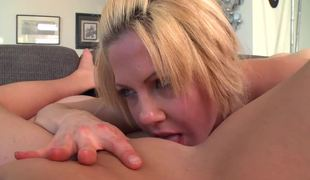 Two girls are licking their horny ally in a lesbian threesome