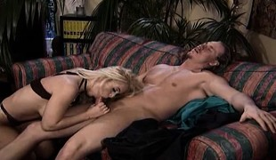 Blonde MILF Dolly Golden, has giant knockers and a very...