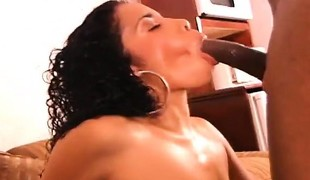 Busty and horny ebony slut spreads her lengthy legs for a huge black pole