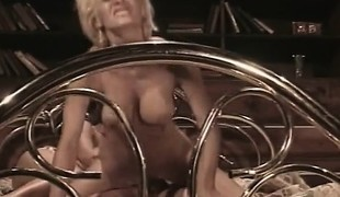 Blonde and dark brown nymphos take turns fucking a hard cock on the bed