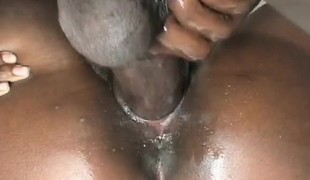 Big breasted chocolate beauty releases her juices on a long black pole