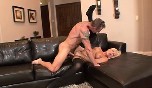 Elegant blonde in darksome stockings Diana Doll gets fucked on the couch