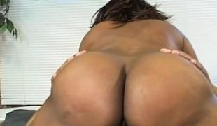 Big booty swarthy lady Coco has a dark dude pleasuring her raunchy urges