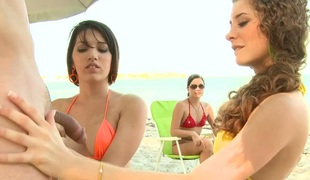 There are three sex hungry bikini girls on the beach. Hot young chicks stroke a cock together and then sweet girl in yellow gets her tight muff pounded doggystyle. Hottie is red is the next.