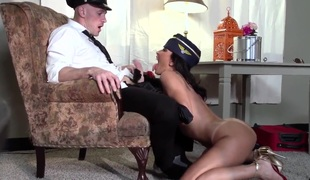 Johnny Sins is having his way with a stewardess. That guy is with her in a hotel room after an exhausting flight. That babe is helping him relax with her sexy tongue.