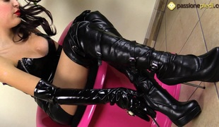 Sexy Eden is wearing leather clothes and craves you to watch her feet