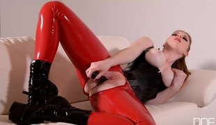Perfect redheaded fetish girl bonks a dark dildo