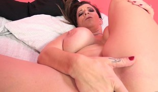 Voluptuous cougar in heat Sara Jay impales herself on a big black pole