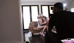 Two hot babes get it on on the couch while this guy watches and films them