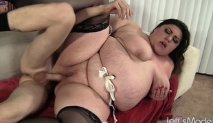 Curvy Bella shoves a large dick down her throat and then wildly fucks it