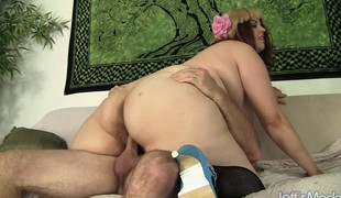Fat housewife in sexy black stockings indulges in a hardcore affair