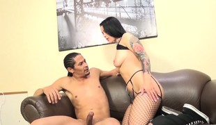 Inked dark brown in fishnet nylons satisfies her lust for black meat
