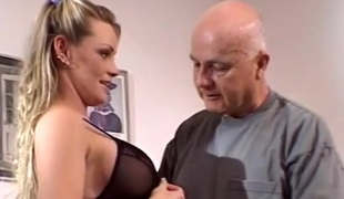 Busty blonde ina Ferrari jumps on a cock in the presence of two dudes