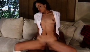 Skinny schoolgirl with miniature tits sits on top of a throbbing dark rod