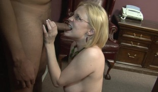Sassy blonde in glasses ball licking before being banged hardcore in an interracial sex