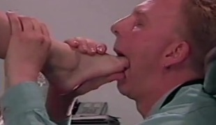 Licking and engulfing the toes of his mistress
