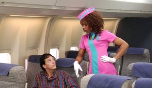 Curly haired stewardess gets a facial from a white stud