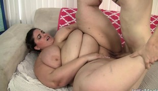 Fat brunette with huge marangos has a long shaft satisfying her needs