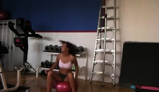 Trainer helps a hottie work out on the equipment in advance of he nails her