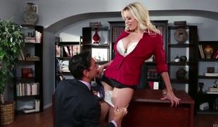 Breath taking busty secretary Stormy Daniels is having wild sex on the boss's table