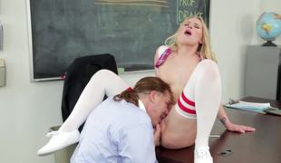 A hardcore babe with a nice cum-hole is fucked in the classroom