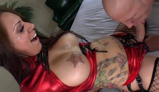 A big a-hole bitch with tattoos and a strap on is fucking her lover