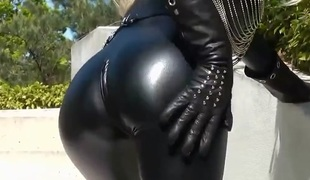 Hot blonde lady dark leather catsuit