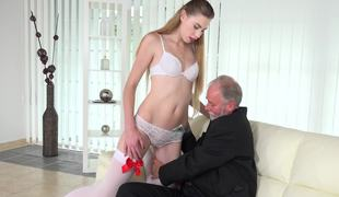 Old businessman fucks a beautiful golden-haired escort on the couch