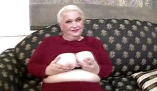 Mature blonde shows off her tits
