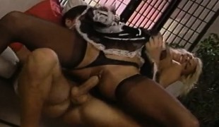 Cheating husband has sex with the ravishing golden-haired maid on the sofa