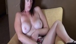 Breasty brunette sits down in order to do the wicked pussy masturbation