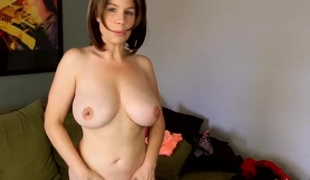 Stripping milf has a breathtaking couple of big tits