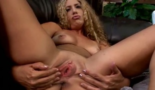 Curly hair milf rubs lotion all over her nude body