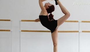 Redheaded ballerina in a little black costume