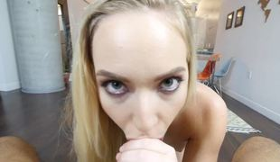 A golden-haired with a slim body is placing her mouth around a big dick to suck