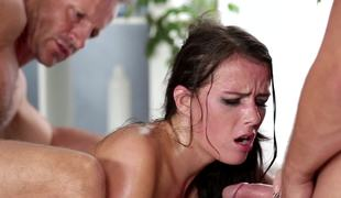 Four men are fucking a hot brunette in a gangbang and she loves it