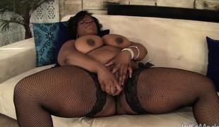 Black skinned plumper in dark stockings enjoys her time with sex toys