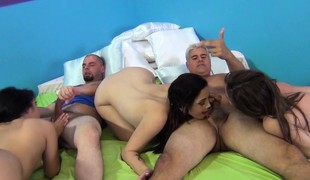 Four attractive babes have fun with vibrators and enjoy two hard dicks