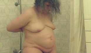 Time worn granny filmed on hidden camera in the bathroom