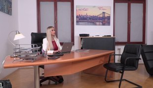 Breathtaking blonde fucks a couple of handsome men on a desk