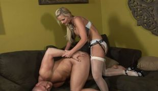 A blonde dominatrix penetrates her thrall with her belt on