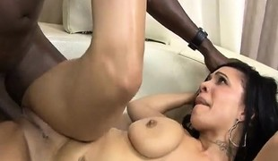 Ebony cutie oils up her marvelous arse and fucks a large darksome prick