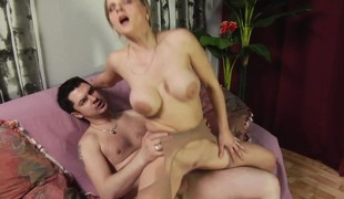 Busty MILF eats his meat and receives a valuable hard fucking on the couch