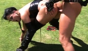 Leather fetish Gabriella is outside getting fucked and sucking him off