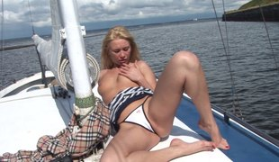Blonde beauty on a yacht stripping and masturbating