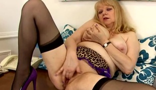 Chubby mom erotically rubbing her muff