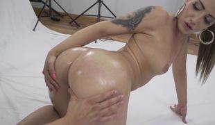 A big ass blond with ink on her arms is worshiping a big pecker