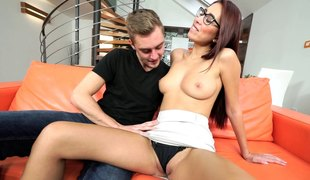 Sweet chick with glasses desires to ride her horny man's chunky prick
