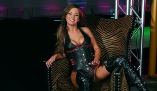 Sizzling brunette wearing leather corset and over-the-knee boots Alice Lighthouse masturbates pussy